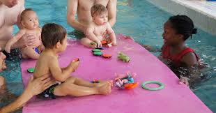 Parent tot children in water