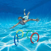Swimmer going to bottom to get Diving Rings